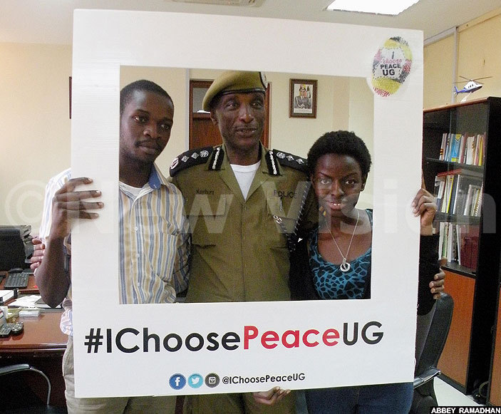 rom left avid dyabhika en ayihura and esire arakire pose for a photo after signing the peace deal