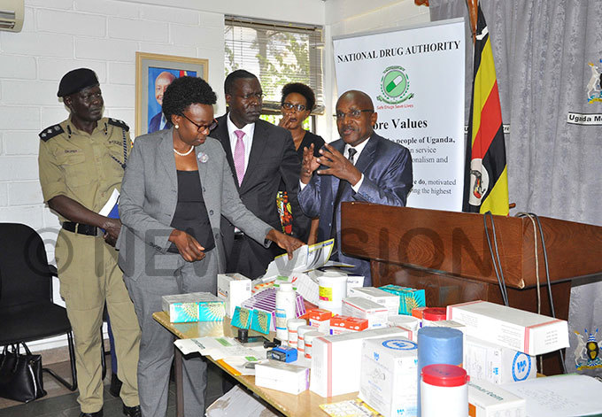 eft to ight  ealth minister  r uth ceng  chairman ational rug uthority edard atekyerezo and acting secretary ational rug uthority avid ahamya displaying some of the drugs impounded by the ministry of health  hoto by ancy anyonga