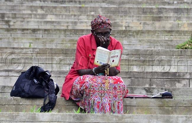 lady reading a book at atholic hine amugongo