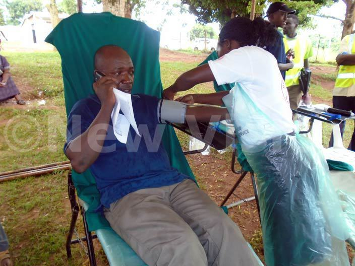 man prepares to donate blood at t pollo ivebulaya