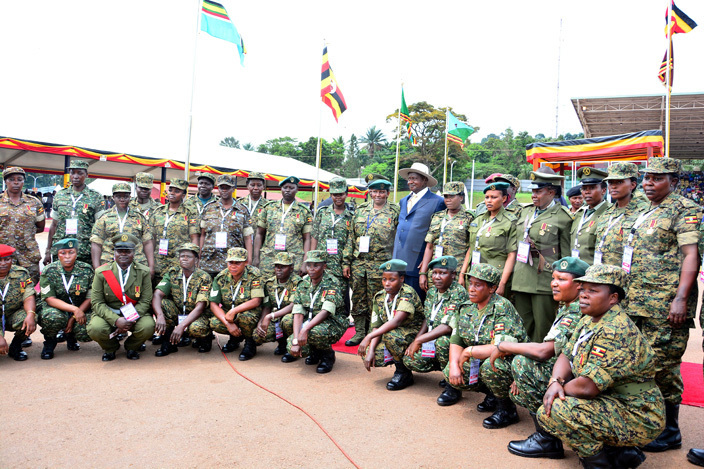 ome of awarded  female officers take a photo with the president useveni iriam amutebi