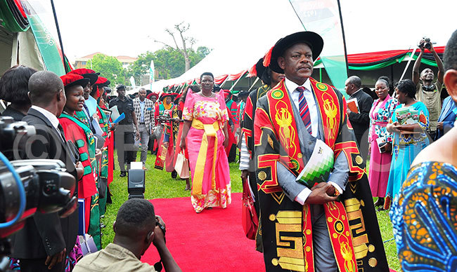 akerere niversity ice hancellor rof arnabas awangwe inister for residency sther bayo and some professors in a procession ahead of the ceremony