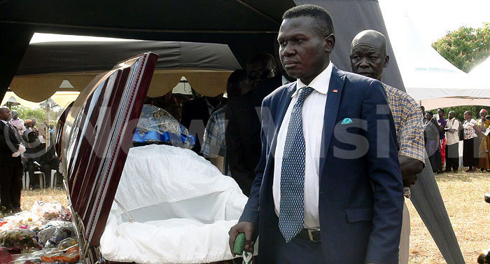 resident eneral orbert ao who lost his father usman kee around the same time as the bonyo family deaths walks past the coffins redit okorachboi