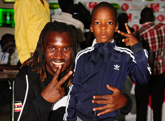 assan asswa poses for a photo with am  ophie ombyas son hoto by ulius enyimba