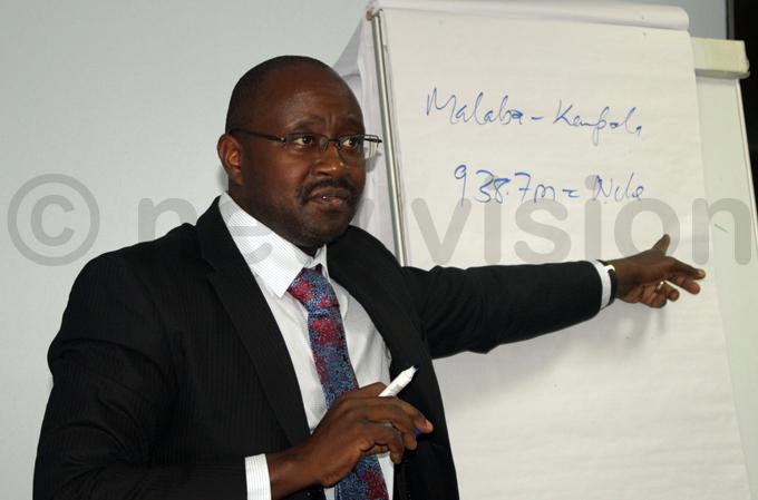 project coordinator asingye yamugambi addresses the media in akawa hoto by acheal assuuna