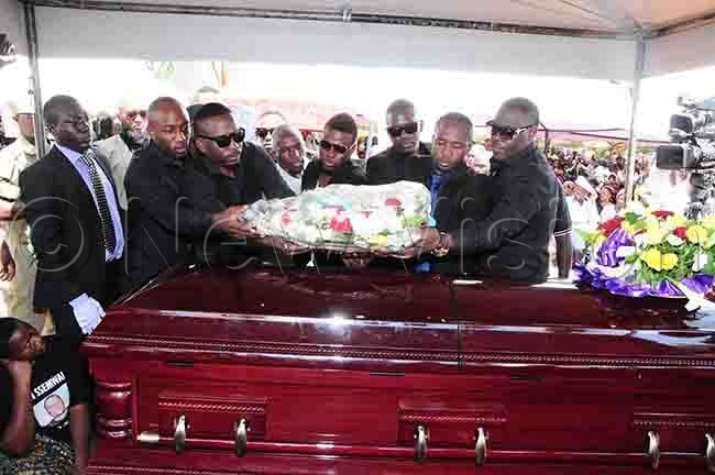ich ang members laying a wreath on semwangas casket
