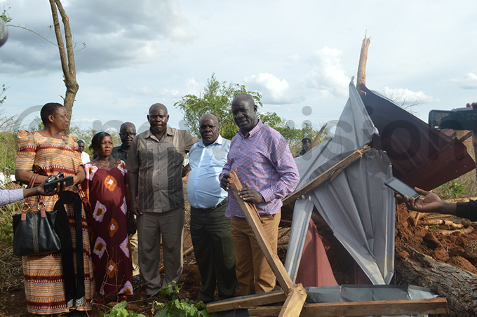 isaster preparedness state minister usa cweru right surveying the damage in uyende district hoto by om webayanga