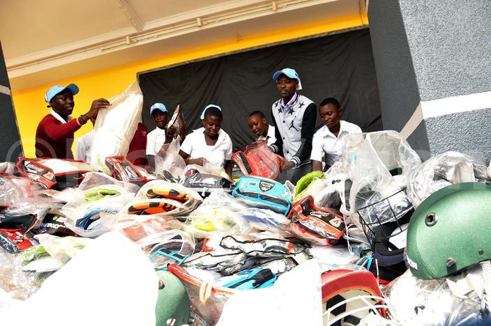 xcited students sift through new cricket equipment donated by