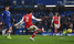 Ten-man Arsenal hold Chelsea to 2-2 draw