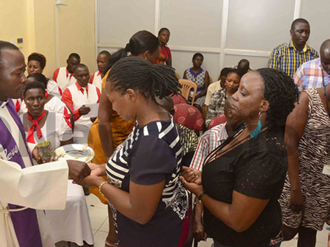 ome of the members of the ision roup nglican community being prayed for hoto by ictoria ampala