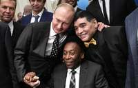 Putin plays football with Infantino 100 days before World Cup