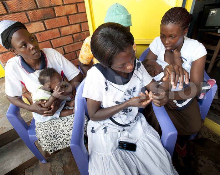 nurse helps out parents with their children at a clinic in itetika