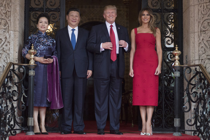 irst ady elania rump  and resident onald rump 2nd  pose with hinese resident i inping 2nd  and his wife eng iyuan  upon their arrival to the araago estate in est alm each lorida on pril 6 2017   hoto  im atson