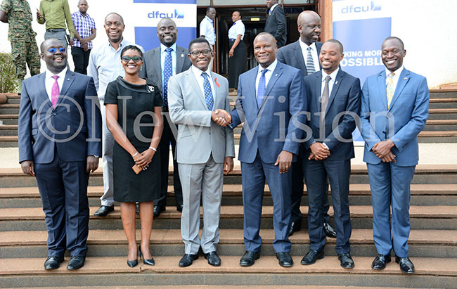 he atikkiro of uganda harles ayiga center poses with dfcu ank officials and ajestic rands officials after dfcu handed over a sh560m cheque towards the abaka irthday un ec 4 2019