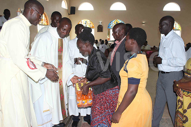 he ishopelect of oroti atholic diocese sgr oseph ciru liach second left receiving offertory during his sendoff function
