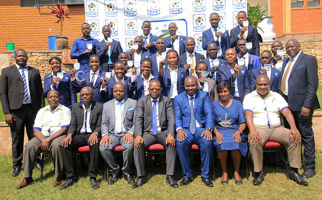 agogo center and other  officials pose with the  referees