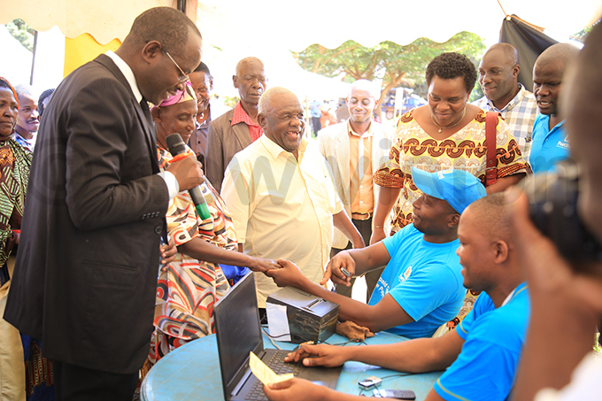 inisters bdul adduli and eace utuuzo witnessing the payment of  grants in iboga hoto by loria akajubi