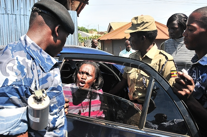 nywar clashed with olicemen as she was being put into a car at ajjansi olice tation before being driven to ntebbe agistrates ourt in pril 2011 ile hoto