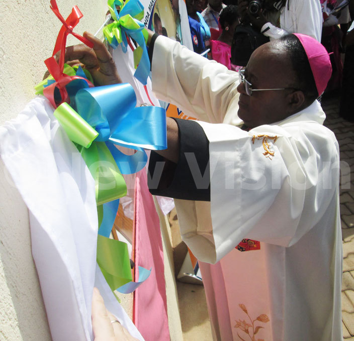 rchbishop wanga unveils the plaque of r oser aternity ing during its inauguration on riday