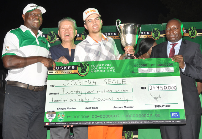 eale was handed a dummy cheque for by   ark citti  and hinese ambassador to hao ali 2nd  and  president ohnson molo hoto by ichael subuga