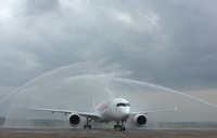 Ethiopian A350XWB 'Siemens'   receives water salutes