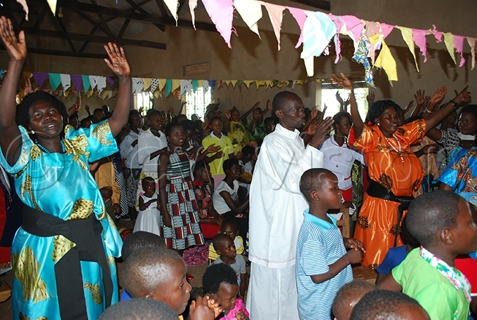 hristians during hristmas celebrations at t aul abuga atholic hurch in ibaale district hoto by ndrew usinguzi