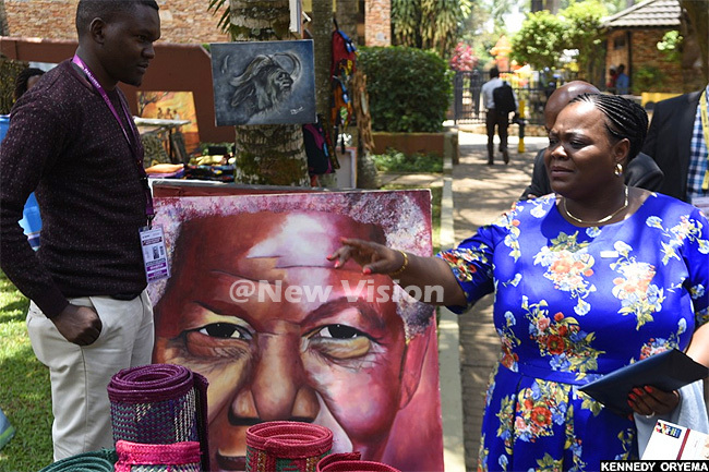 he resident of the esotho senate amonaheng okitimi admires an artpiece of elson andela at the exhibition area at unyonyo