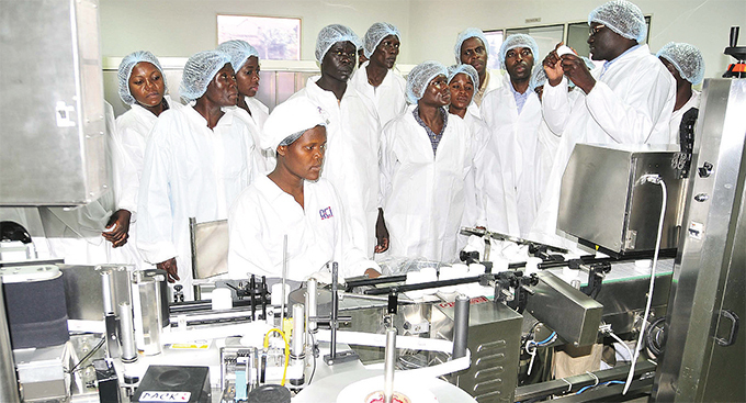 uality hemicals ompany pharmacist amuel pio in 2012 demonstrating how  drugs are manufactured