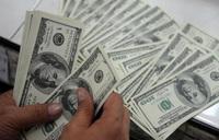 Shilling gains against dollar