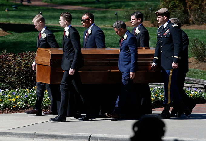 casket carrying the body of ev illy raham is carried to his funeral service at the illy raham ibrary on arch 2 2018 in harlotte orth arolina  rian lancoetty mages