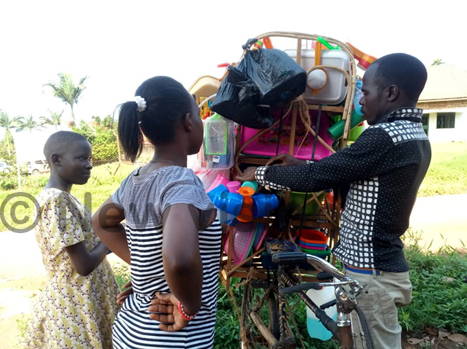 icycle delivering household items in pper augga ukono hotos by imothy urungi