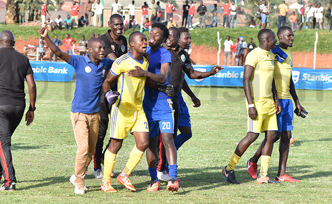 amuzah uwonge is mobbed by teammates and fans alike after his heroics hoto by ichard anya