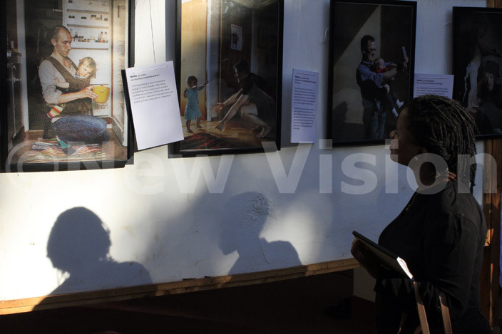 osebell agumire looks at some of the shots during the exhibition hoto by bou isige
