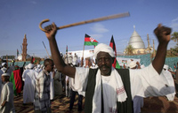 On coup anniversary Sudan ex-PM urges regime to go