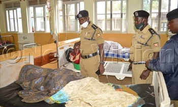 Police detectives as they visited mugaju at his sick bed at kawolo hospital where he was admitted on thursday photo by jackie nambogga 350x210