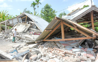 Strong quake kills 13, injures hundreds on Indonesia holiday island