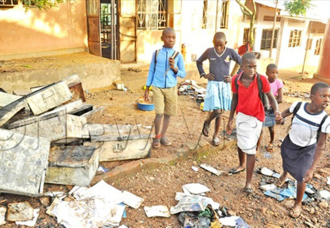 upils of igoti tandard rimary chool in ityana district walking past the destroyed items