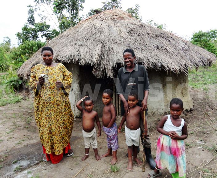 he akurus stand in front of their former village home which already housed six children and was leaking