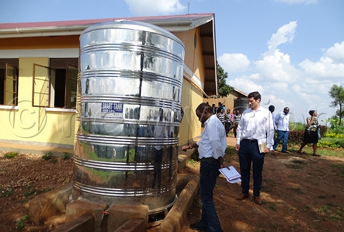 orld anks ichael unavu and hris ahony inspect a water tank at akoni rimary chool in yegegwa district hoto by addeo wambale