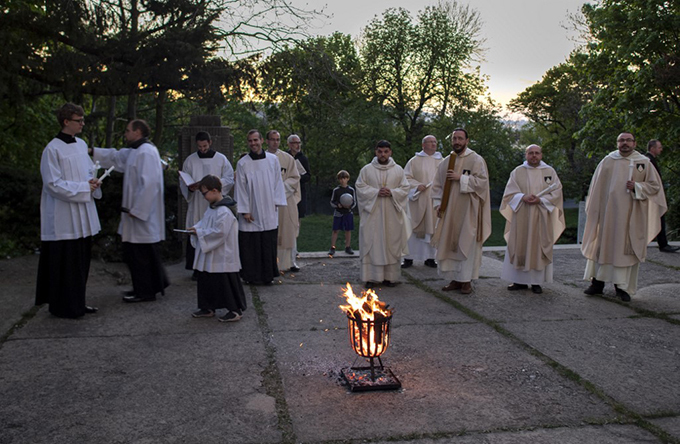 atholic priests celebrate the oly aturday aster igil in the catholic church of aint ary of nows in ratislava lovakia  hoto