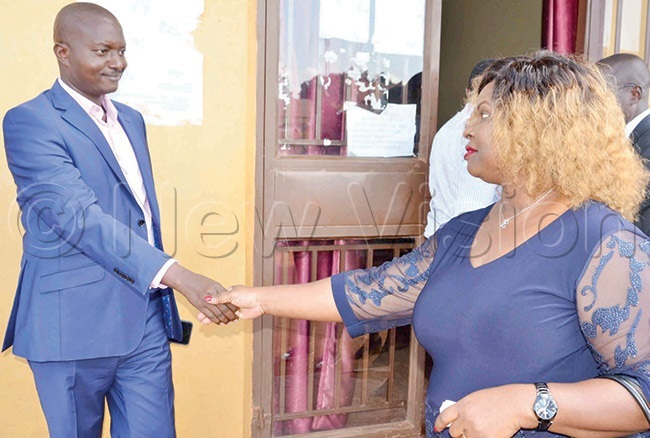 ugingo greeting eddy at court in ajjansi ntebbe