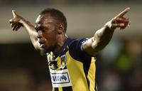 Bolt hits first goals in football bid