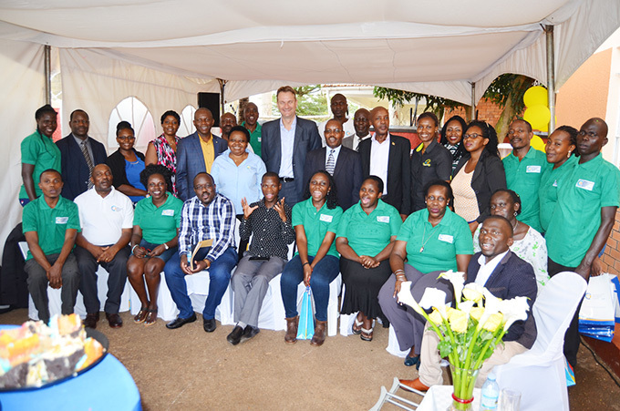 mbassador enk an akker poses for a group photo with the staff and stakeholders of