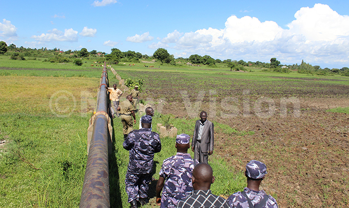 vironmental police officers inspecting a degraded wetland in oroti ub ounty oroti district