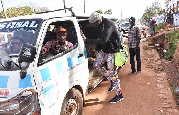 oxer iwanuka hafik boards a taxi in itebi hoto by ohnson ere