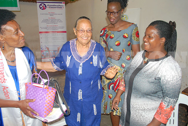 uliana ezuldenout the private secretary of the president of older persons centre chats with members of the randmothers onsortium