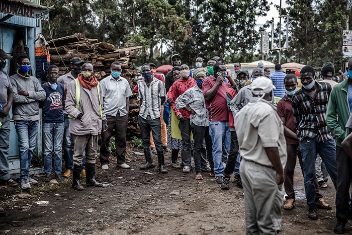 eople queue while waiting their turn to be tested during the 19 coronavirus mass testing exercise inducted by enyas inistry of ealth in the awangware slums of airobi enya on ay 1 2020 hoto by