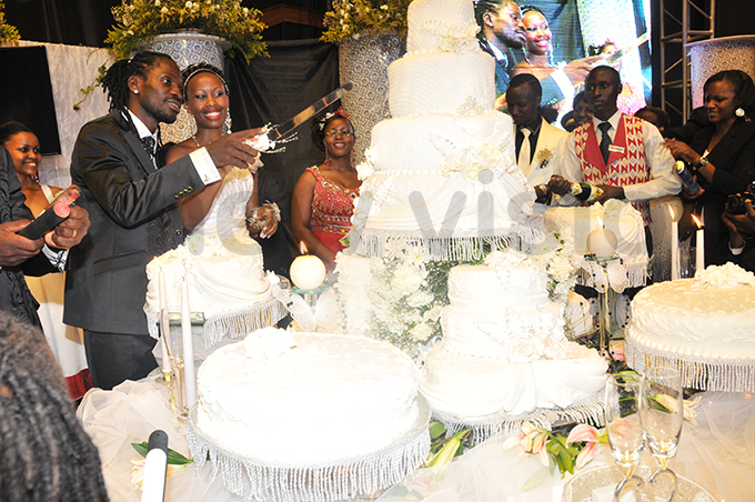 he newlyweds cut a cake during the function