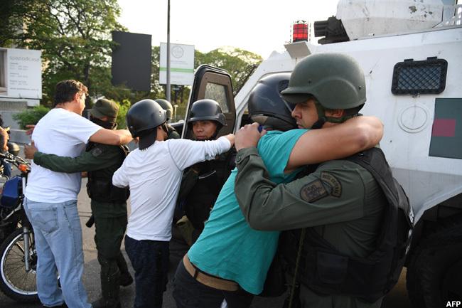 enezuelans hug members of the security forces in aracas