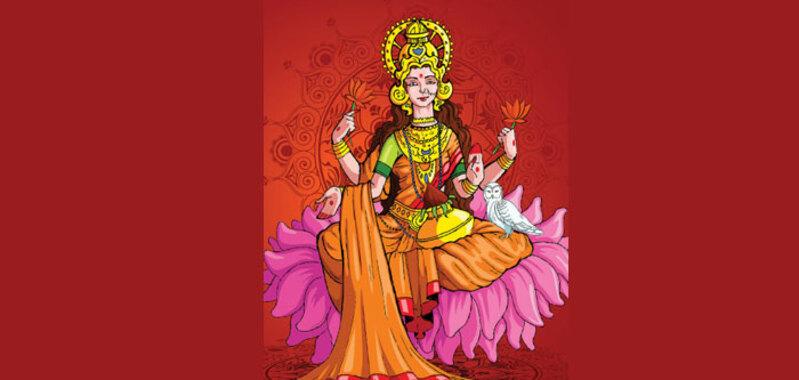 लक्ष्मी को प्रिय उल्लू, कौड़ी और कमल